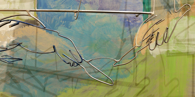 A contemporary blue and green painting with wire overlay shaped into hands holding knives